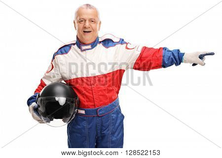 Mature car racer holding a helmet and pointing to the right isolated on white background