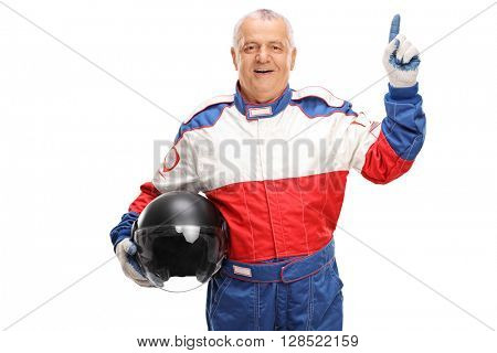 Mature car racer holding a gray helmet and pointing up with his finger isolated on white background