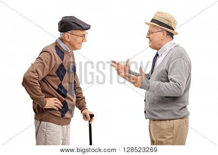Two senior gentlemen talking to each other and smiling isolated on white background