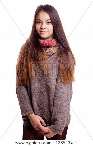 shy asian teenage girl wearing scarf and sweather