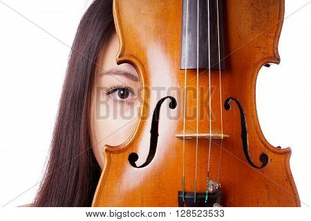 young asian woman peeking from behind violin or fiddle