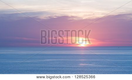 Blur beautiful soft blue and orange sky above the sea. Sunset in background. Abstract blue orange sky. Dramatic blue sky at the sunset background.
