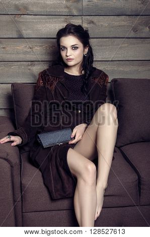 Beautiful Girl Sitting On A Couch In A Country House