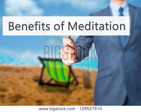 Benefits Of Meditation - Businessman Hand Holding Sign