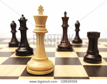 Wood Chess Pieces isolated on chess board