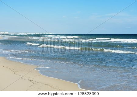sand beach and blue sea in a summer day Apulia southern Italy