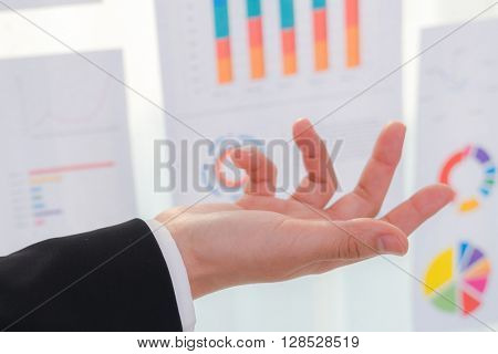 Business people  with finance chart