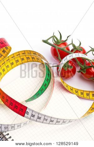 Notebook With Metering Tape And Tomatoes On White