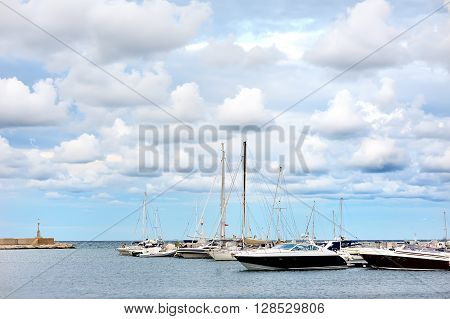boats in a summer cloudy day in the port of Ostuni Apulia southern Italy