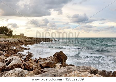 sea on the rocks in a cloudy day Ostuni Apulia southern Italy