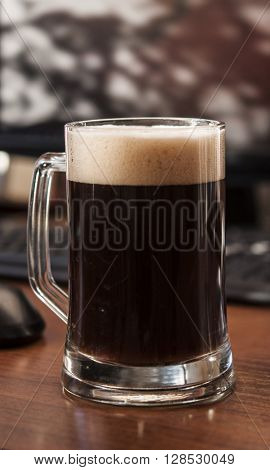 Glass of beer on wooden table