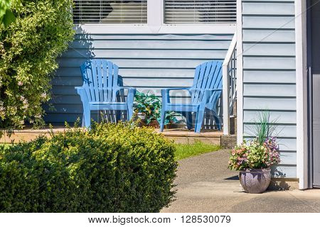 Outdoor landscape garden with two chairs in North Vancouver, British Columbia, Canada.