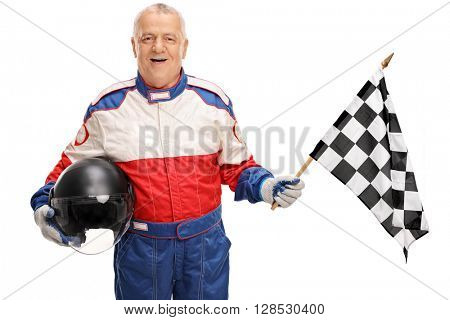 Mature man in a racing uniform holding a checkered race flag isolated on white background