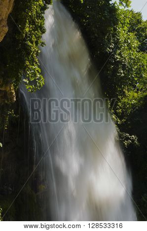 Waterfall. drop of water in the river from the ledge. The sharp drop height of the riverbed and a steep fall