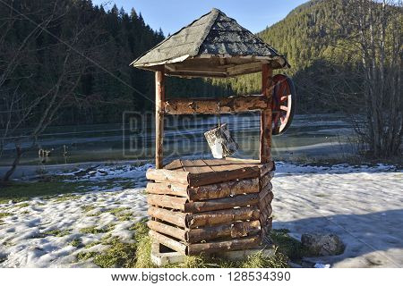 Rural water fountain in Red Lake (Romania)
