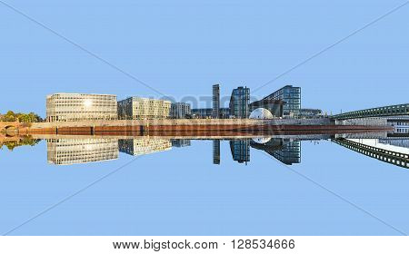 morning view of Central station with reflection from river Spree in Berlin Germany