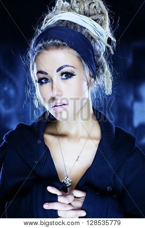 Portrait of a beautiful woman with dreadlocks studio shot