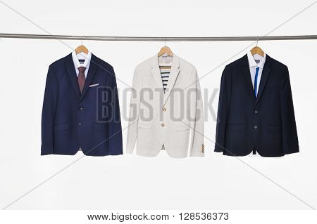 Three suits Shirts with ties on wooden hangers
