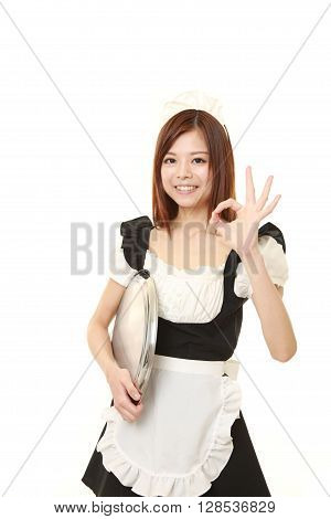 young Japanese woman wearing french maid costume showing perfect sign