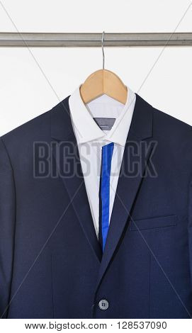 A close up shot of suit clothes hanging