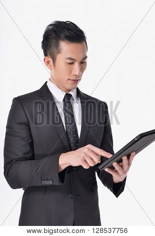 handsome young asian businessman Using Digital Tablet Isolated