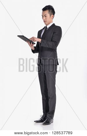 young businessman Using Digital Tablet Isolated in studio  young businessman Using Digital Tablet Isolated in studio