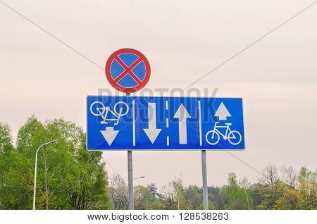 Traffic signs on the street. Road signs for bicycles and no stopping.