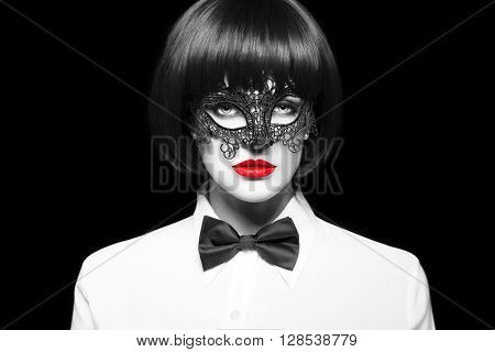 Sexy woman in wig and mask isolated black and white selective coloring