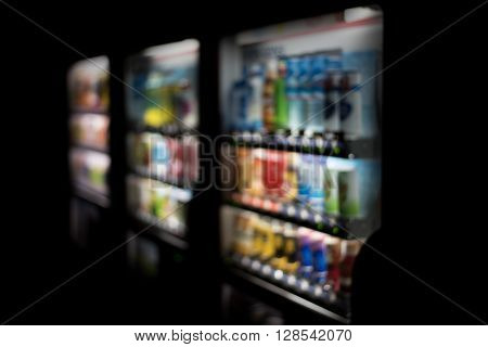 Blurred / Defocussed abstract background of colorful soft drinks / juice bottles vending machines taken in Japan