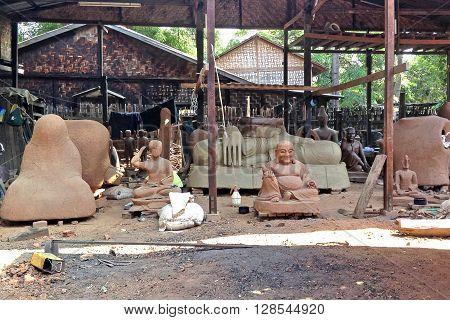 AMARAPURA, MYANMAR-APRIL 21 : Traditional bronze Buddha statue production in open-air workshop  APRIL 21, 2013 in Amarapura, Myanmar.