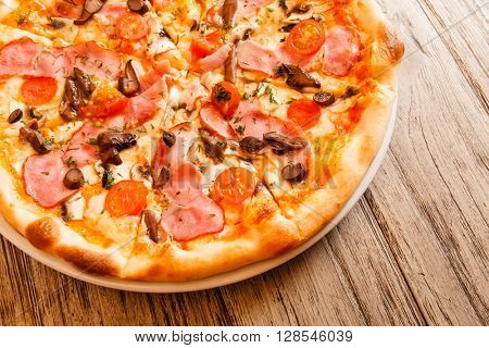 pizza on wooden background