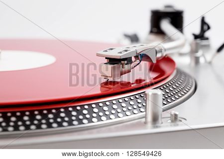 Turntable Needle On A Red Plate