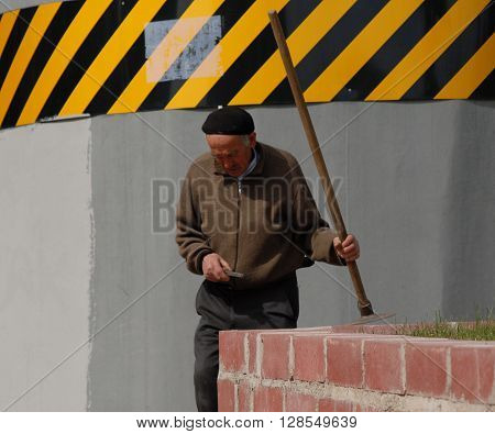ANKARA/TURKEY-APRIL 24, 2016: Old man at the Sentepe Ropeway Station with digging equipment. April 24, 2016-Ankara/Turkey