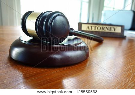 Judge's legal gavel and Attorney nameplate on desk