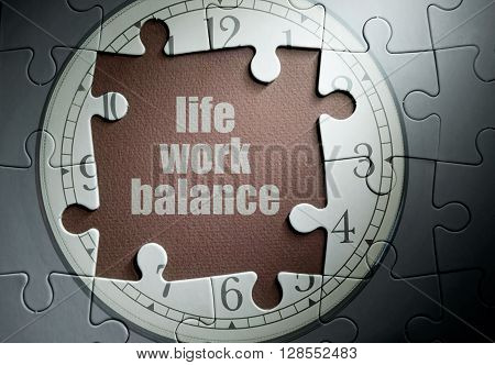 Life work balance missing piece from a clock jigsaw puzzle