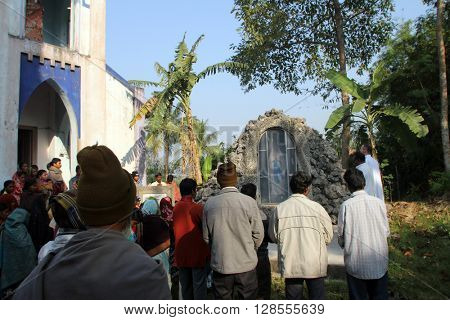 BAIDYAPUR, INDIA - DECEMBER 02: Prayer in front of Our Lady of Lourdes church in Baidyapur, West Bengal, India on December 02, 2012.