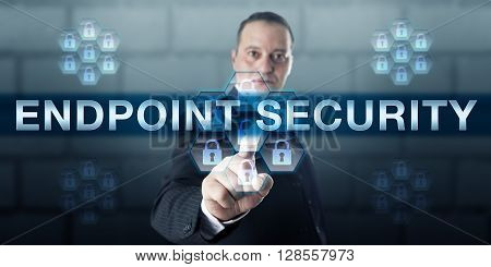 Manager is pushing ENDPOINT SECURITY on a virtual touch screen interface. Information technology and security concept for software and technology protecting corporate computing networks.