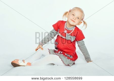 Portrait of an adorable baby girl blonde. Girl smiling