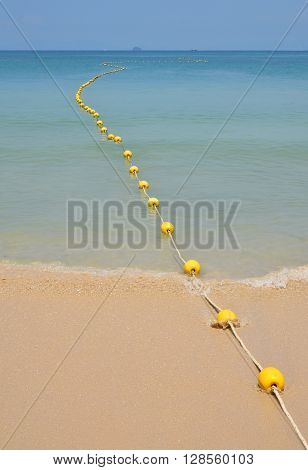 Yellow Buoys At Sea Beach In Perspective