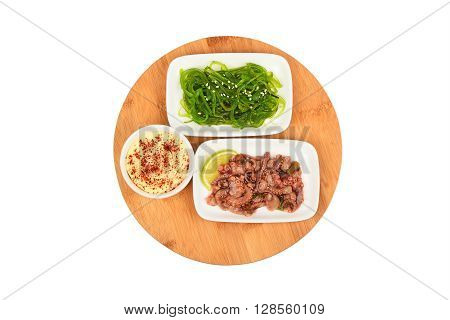 Two Seafood Salads On Wooden Plate