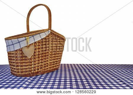 Picnic Basket On The Blue Checkered Tablecloth Isolated On White