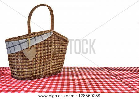 Picnic Basket On The Red Checkered Tablecloth Isolated On White