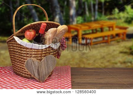 Picnic Basket With Wine Bottle, Bread And Fruits On  Table