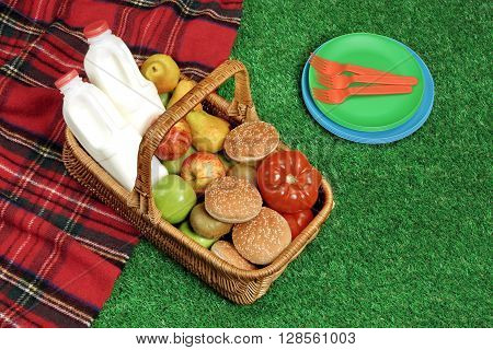 Top View Of Picnic  Basket  On The Red Tartan Blanket