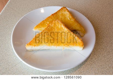 Fried triangle bread with cheese and butter concept