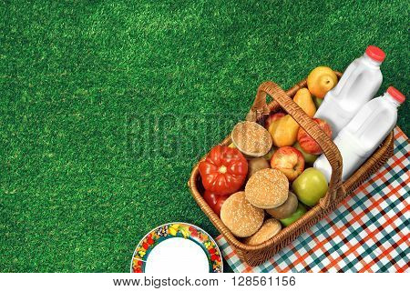 Top View Of Picnic  Basket  On The Fresh Lawn
