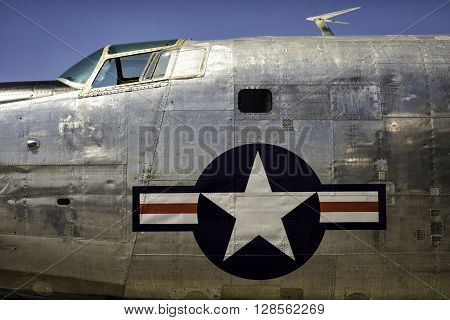 Vintage plane fuselage with large United States retro Air corps insignia.