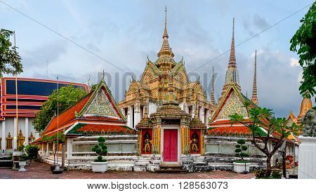 Panorama of Wat Pho Temple at sunset in Bangkok Thailand. Wat Pho known also as the Temple of the Reclining Buddha. ** Note: Soft Focus at 100%, best at smaller sizes