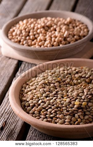 Clay Bowls With Lentils And Chickpeas On Wooden Board