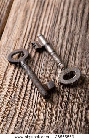 Two Keys With Rust On Woden Board